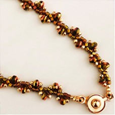 Flat Spiral Micro Faceted Spacer Bead Necklace, a free pattern by Leslie Venturoso
